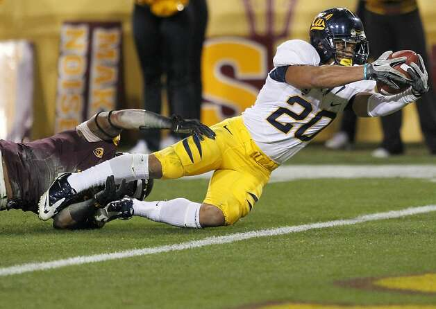 California running back Isi Sofele (20) scores a touchdown as Arizona State safety Clint Floyd defends during the first half of an NCAA football game on Friday, Nov. 25, 2011, in Temp, Ariz. (AP Photo/Matt York)   Ran on: 11-26-2011 Cal tailback Isi Sofele lunges for a first-half touchdown. He gained 145 yards on 21 carries. Ran on: 11-26-2011 Cal tailback Isi Sofele lunges for a first-half touchdown. He gained 145 yards on 21 carries, his fifth 100-yard game this season. Photo: Matt York, AP