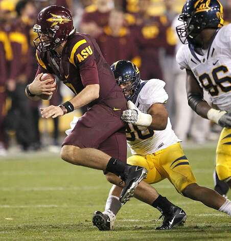 Arizona State quarterback Brock Osweiler, left, is sackecd by California linebacker Mychal Kendricks during the second half of an NCAA college football game Friday, Nov. 25, 2011, in Temp, Ariz. (AP Photo/Matt York) Photo: Matt York, AP