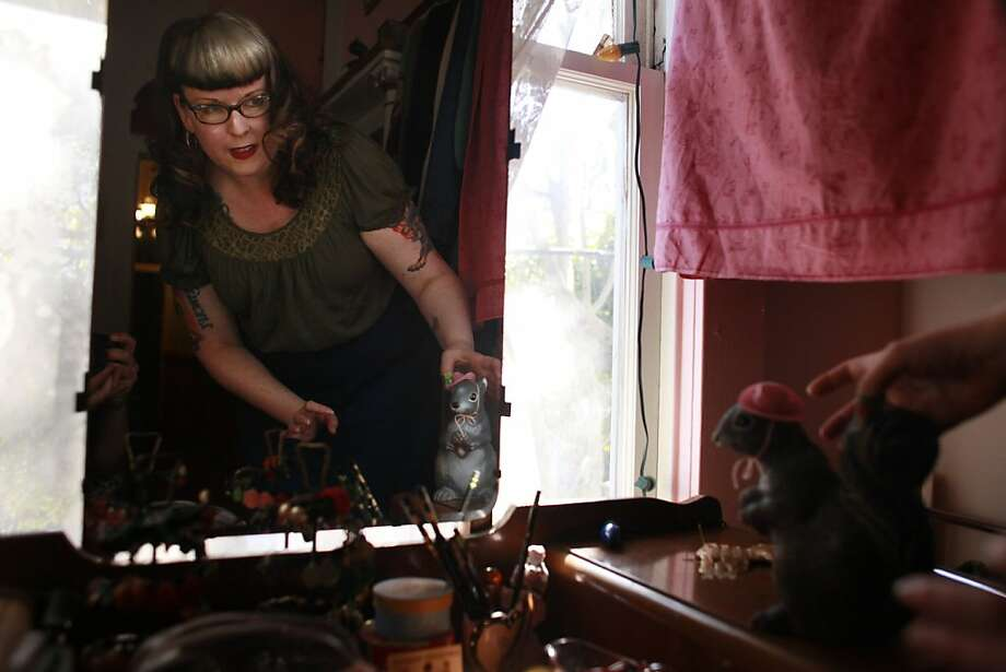 """""""Because she's so photogenic  - I kind of see her as a superstar in the making. Who knows what tomorrow will bring for Lolly,"""" said Penny Skwish putting the final touches on Lolly Squirrel's outfit for the day. Photo: Mike Kepka, The Chronicle"""