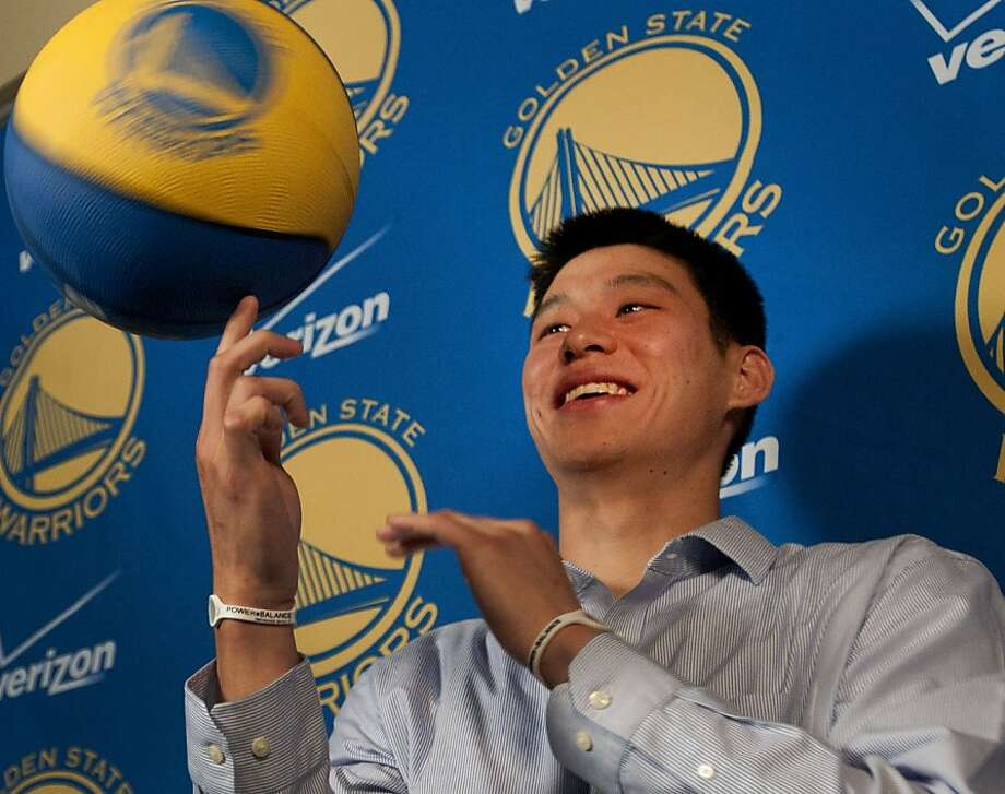 The Golden State Warriors newest member, Jeremy Lin, spins a basketball on his finger in front of members of the media in Oaklance, Calif., on Wednesday, July 21, 2010.  Ran on: 07-22-2010 Palo Alto High alumnus Jeremy Lin has stepped from the Ivy League into the big league  --  the NBA. Ran on: 07-22-2010 Palo Alto High alumnus Jeremy Lin has stepped from the Ivy League into the big league  --  the NBA. Photo: Chad Ziemendorf, The Chronicle