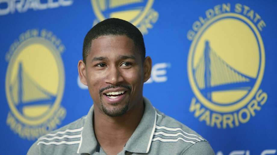 Newly acquired Golden State Warriors guard Charlie Bell smiles at a NBA basketball news conference at Warriors headquarters in Oakland, Calif., Monday, June 28, 2010. Bell was acquired from the Milwaukee Bucks. (AP Photo/Paul Sakuma)  Ran on: 06-30-2010 Charlie Bell spent the last five seasons with the Milwaukee Bucks and says his defensive skills will help upgrade the Warriors. Ran on: 06-30-2010 Charlie Bell spent the last five seasons with the Milwaukee Bucks and says his defensive skills will help upgrade the Warriors.  Ran on: 10-04-2010 Charlie Bell will play both guard positions after the departure of C.J. Watson. Ran on: 10-04-2010 Charlie Bell will play both guard positions after the departure of C.J. Watson. Photo: Paul Sakuma, AP