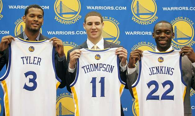 Golden State Warriors 2011 draft picks Jeremy Tyler, left, Klay Thompson, center, and Charles Jenkins show their jerseys during a news conference on Monday, June 27,  in Oakland Calif.  Ran on: 11-13-2011 Washington State's Klay Thompson was the new owners' first draft pick. Photo: Mathew Sumner, Special To The Chronicle