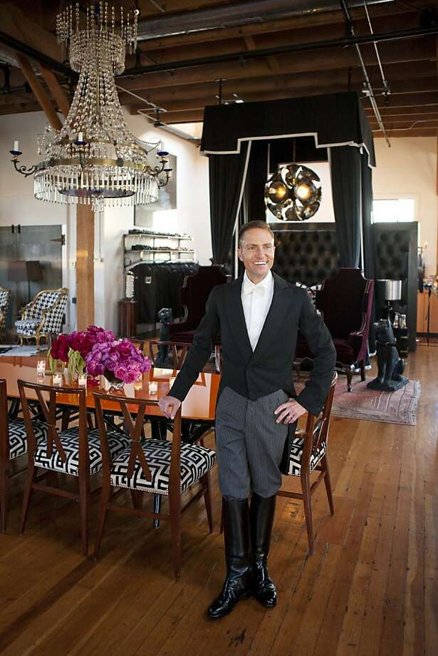 "Interior designer Ken Fulk hosted a party for the launch of his new ground-level interior design boutique at 310 7th St. on Sept. 22, 2011. The party, called ""Peep Show,"" drew 800 well-heeled guests and featured a carnival in a parking lot adjacent the building. Here, Ken Fulk as grandmaster of the evening's events, in his apartment loft at the top of his design studio. Photo: Drew Altizer"