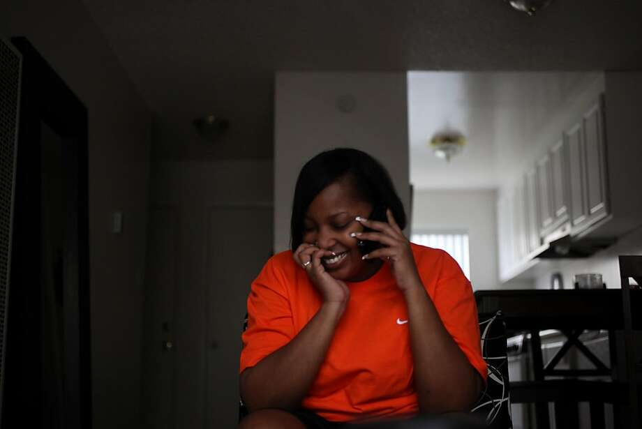 Season of Sharing recipient, Felicia Shavies wishes her eldest son a happy birthday on the phone in the living room of her new apartment on Wednesday Nov. 23, 2011 in Hayward, Calif. SOS helped her with the deposit on a new apartment. Photo: Mike Kepka, The Chronicle