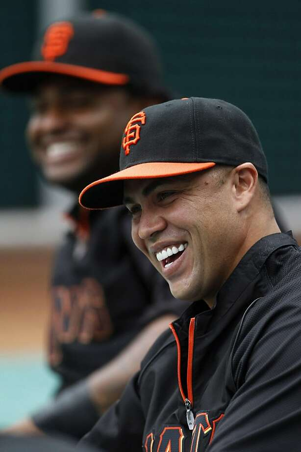 San Francisco Giants' Carlos Beltran, right, and Pablo Sandoval laugh as they stretch before a baseball game against the Philadelphia Phillies, Thursday, July 28, 2011, in Philadelphia. (AP Photo/Matt Slocum)  Ran on: 07-31-2011 The Giants' Pablo Sandoval (left) laughs with new teammate Carlos Beltran while stretching before Thursday's game. Photo: Matt Slocum, AP