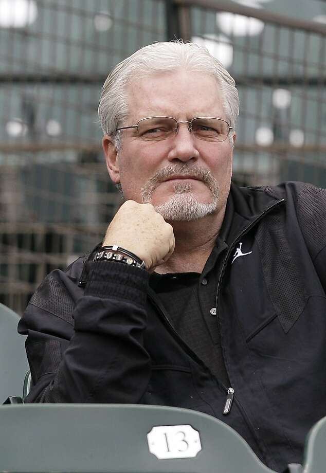 San Francisco Giants general manager Brian Sabean watches batting practice before a baseball game against the Colorado Rockies in San Francisco, Friday, June 3, 2011. Florida Marlins rookie Scott Cousins has been receiving death threats despite repeatedlyapologizing for a collision with San Francisco Giants star Buster Posey. Sabean criticized Florida Marlins rookie Scott Cousins on his weekly radio show on KNBR this week, calling the play malicious and unnecessary. Photo: Jeff Chiu, AP