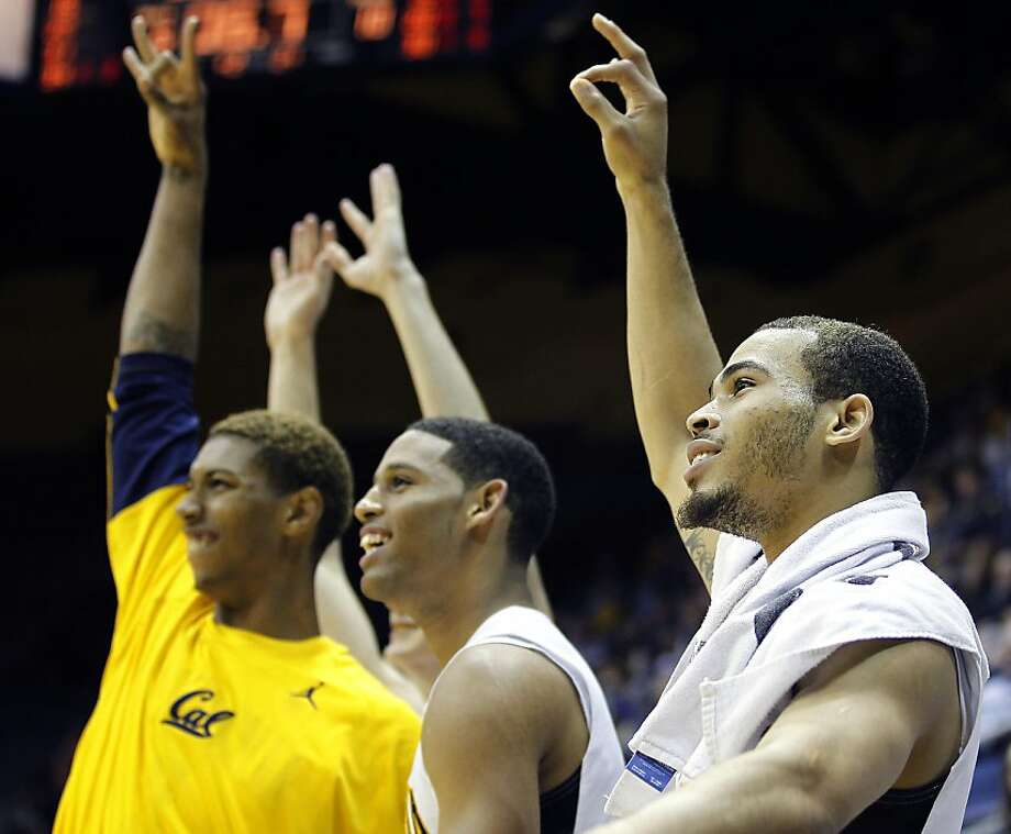 California's Justin Cobbs, right, Allen Crabbe, center, and Richard Solomon, left, celebrate their 80-59 victory over Denver in an NCAA college basketball game in Berkeley, Calif., Saturday, Nov. 26, 2011. (AP Photo/Tony Avelar) Photo: Tony Avelar, AP