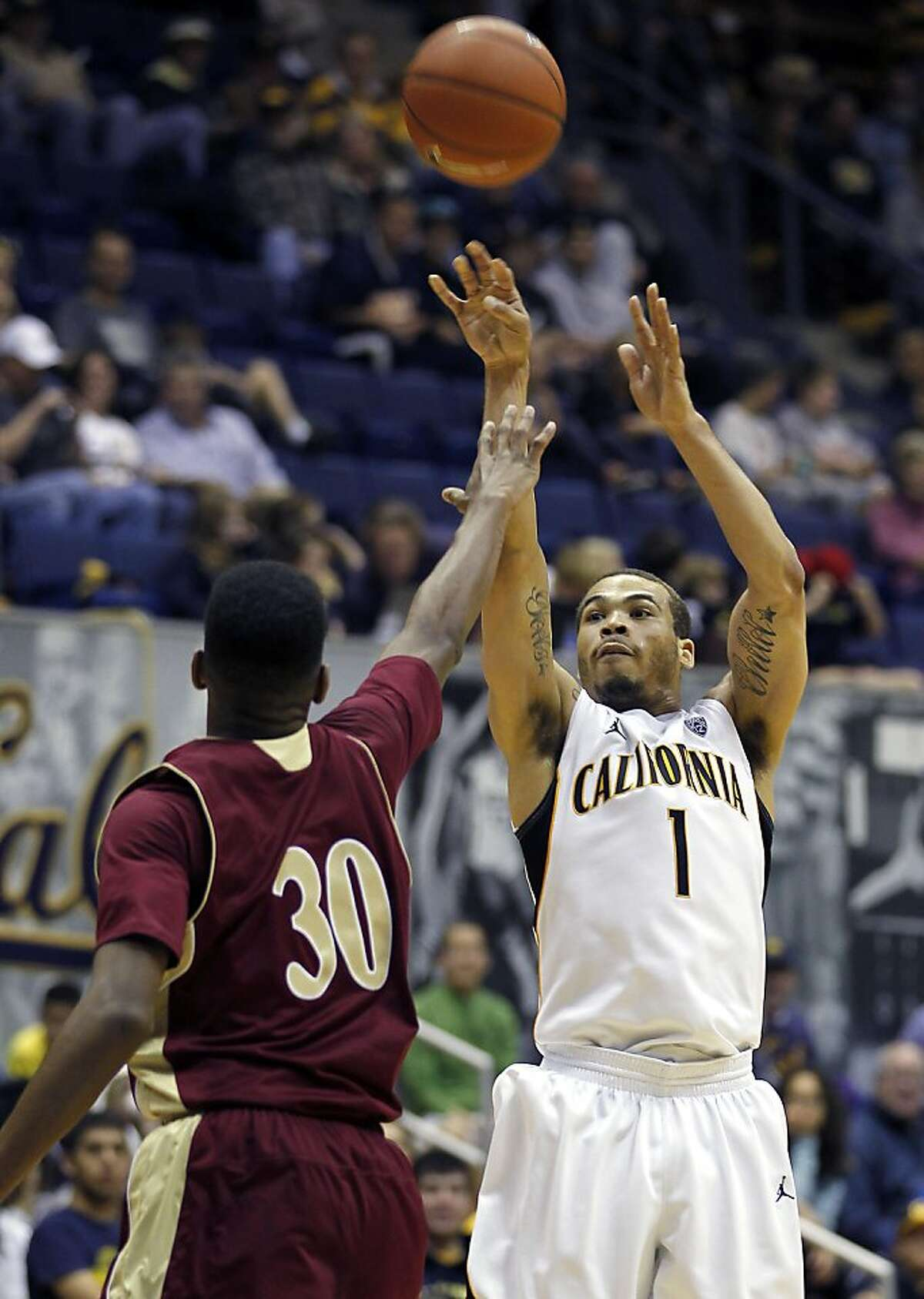 California guard Justin Cobbs (1) takes a shot over Denver guard Cam Griffin (30) during the second half of an NCAA college basketball game in Berkeley, Calif., Saturday, Nov. 26, 2011. California won 80-59. (AP Photo/Tony Avelar)