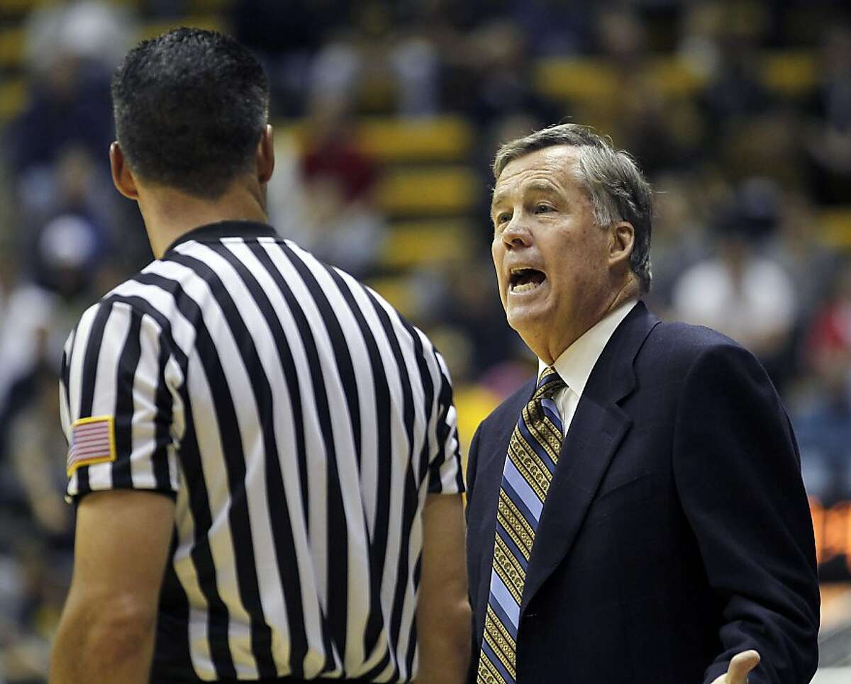California head coach Mike Montgomery, right, argues a call with a referee during the second half against Denver in an NCAA college basketball game in Berkeley, Calif., Saturday, Nov. 26, 2011. California won 80-59. (AP Photo/Tony Avelar)