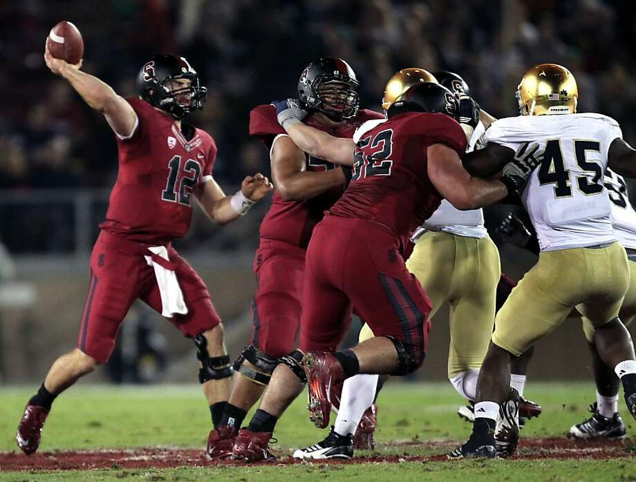Stanford Cardinal quarterback Andrew Luck escapes the Notre Dame rush and completes a first quarter pass at Stanford Stadium on November 26 2011 in Stanford, California.The Cardinal defeated the Fighting Irish 28-14. Photo: Lance Iversen, The Chronicle