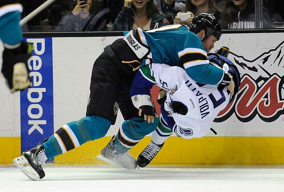 SAN JOSE, CA - NOVEMBER 26: Brad Winchester #10 of the San Jose Sharks takes Aaron Volpatti #54 of the Vancouver Canucks to the ice during a fight at HP Pavilion at San Jose on November 26, 2011 in San Jose, California.  (Photo by Thearon W. Henderson/Getty Images) Photo: Thearon W. Henderson, Getty Images
