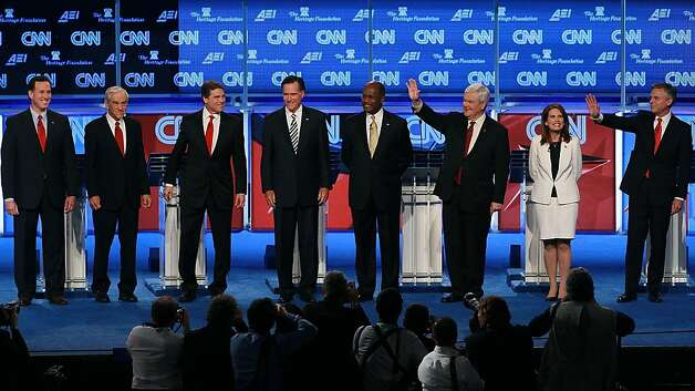 WASHINGTON, DC - NOVEMBER 22:  Republican presidential candidates (L-R) Rick Santorum, Rep. Ron Paul, Texas Gov. Rick Perry, Mitt Romney, Herman Cain, Newt Gingrich, Rep. Michele Bachmann, and Jon Huntsman are introduced prior to a debate at ConstitutionHall November 22, 2011 in Washington, DC. The debate, hosted by CNN andÌ?in partnership with the Heritage Foundation and the American Enterprise Institute, was expected to focus primarily on national security, foreign policy and the economy. (Photo by Mark Wilson/Getty Images) Photo: Mark Wilson, Getty Images