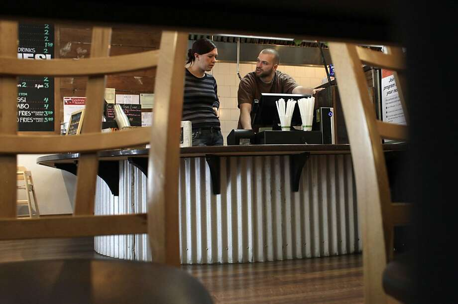 Carolyn  Kissick gets instruction from Amin Hosseini as they work the register at the Curry Up Now restaurant,  Wednesday November 23, 2011, in San Mateo, Calif.  Photo: Lacy Atkins, The Chronicle