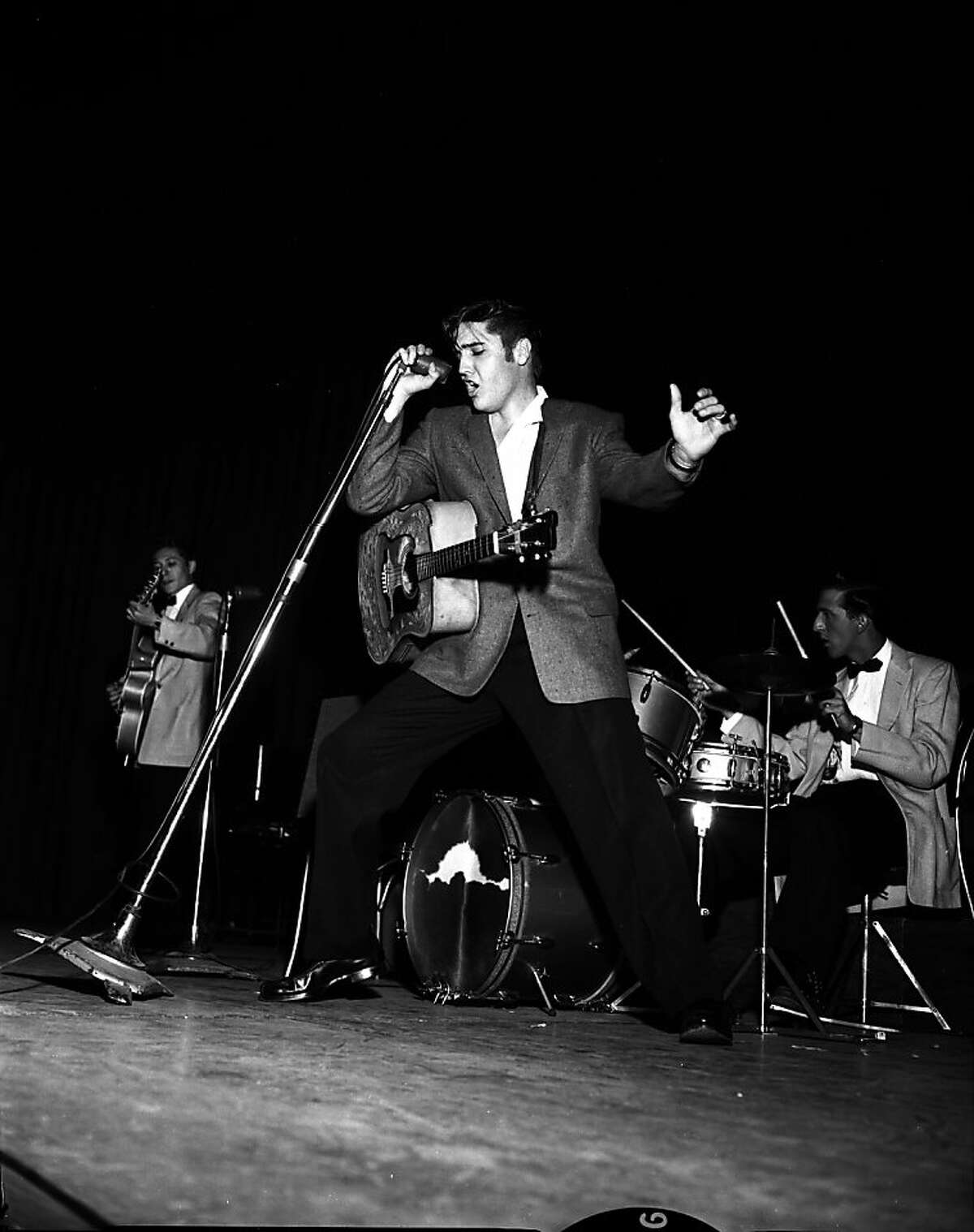 PRESLEY11-21JUN56-CAMPBELL - Elvis Presley at the 1956 Presley Concert in Oakland. Photo by Bob Campbell Ran on: 05-28-2006 Elvis Presley did two shows in Oakland on June 3, 1956. Ran on: 11-27-2011 Photo caption Dummy text goes here. Dummy text goes here. Dummy text goes here. Dummy text goes here. Dummy text goes here. Dummy text goes here. Dummy text goes here. Dummy text goes here.###Photo: fiveplaces13_ph20Chronicle###Live Caption:Elvis Presley at the 1956 concert in Oakland.###Caption History:PRESLEY11-21JUN56-CAMPBELL - Elvis Presley at the 1956 Presley Concert in Oakland. Photo by Bob Campbell Ran on: 05-28-2006 Elvis Presley did two shows in Oakland on June 3, 1956.###Notes:###Special Instructions: