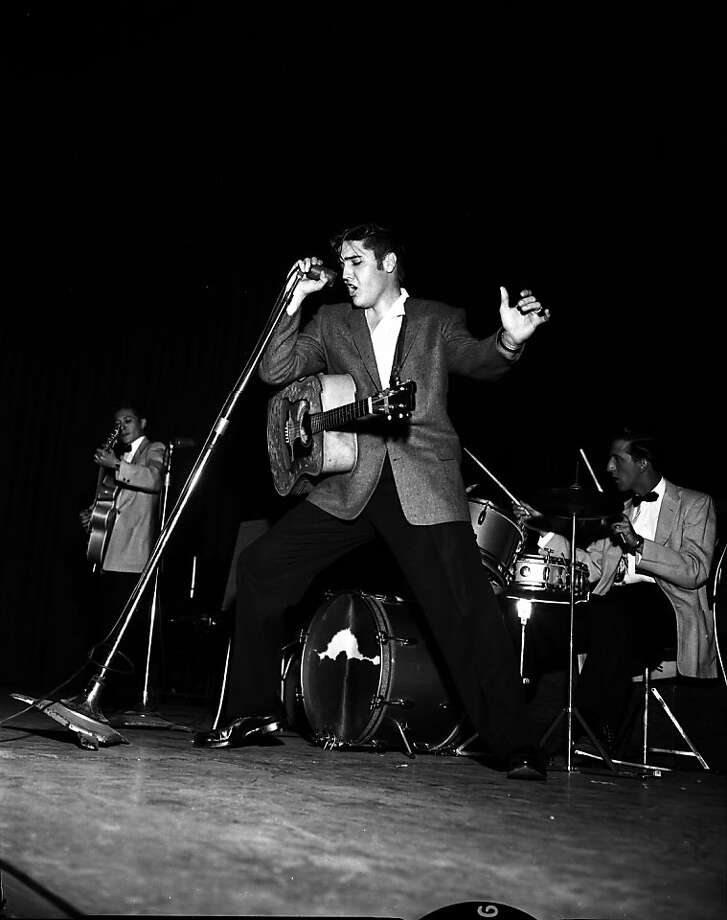 PRESLEY11-21JUN56-CAMPBELL - Elvis Presley at the 1956 Presley Concert in Oakland.  Photo by Bob Campbell Ran on: 05-28-2006 Elvis Presley did two shows in Oakland on June 3, 1956.  Ran on: 11-27-2011 Photo caption Dummy text goes here. Dummy text goes here. Dummy text goes here. Dummy text goes here. Dummy text goes here. Dummy text goes here. Dummy text goes here. Dummy text goes here.###Photo: fiveplaces13_ph20Chronicle###Live Caption:Elvis Presley at the 1956 concert in Oakland.###Caption History:PRESLEY11-21JUN56-CAMPBELL - Elvis Presley at the 1956 Presley Concert in Oakland.  Photo by Bob Campbell  Ran on: 05-28-2006  Elvis Presley did two shows in Oakland on June 3, 1956.###Notes:###Special Instructions: Photo: Bob Campbell, The Chronicle 1956