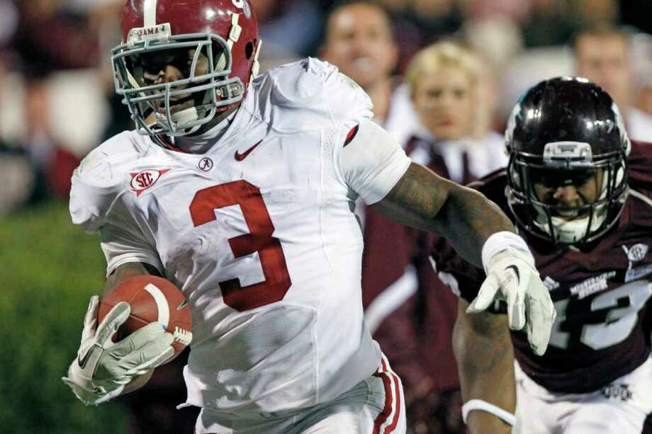 Alabama running back Trent Richardson (3) runs past Mississippi State defensive back Johnthan Banks (13) for a first down in the fourth quarter of their NCAA college football game in Starkville, Miss., Saturday, Nov. 12, 2011. No. 4 Alabama won 24-7. Photo: AP