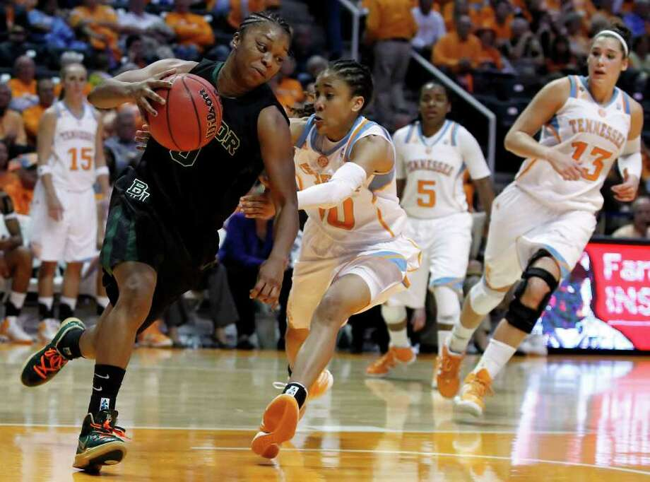 Baylor guard Odyssey Sims drives past Tennessee guard Meighan Simmons, a Steele product, in the second half. Photo: AP