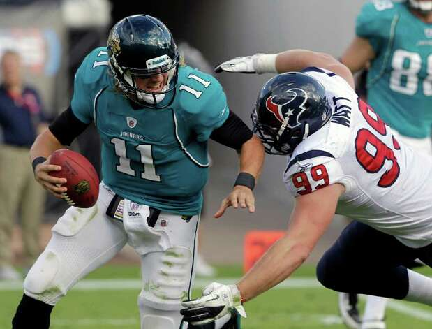 Houston Texans defensive end J.J. Watt (99) sacks Jacksonville Jaguars quarterback Blaine Gabbert (11) during the second half of an NFL football game on Sunday, Nov. 27, 2011, in Jacksonville, Fla. Houston won 20-13. Photo: AP