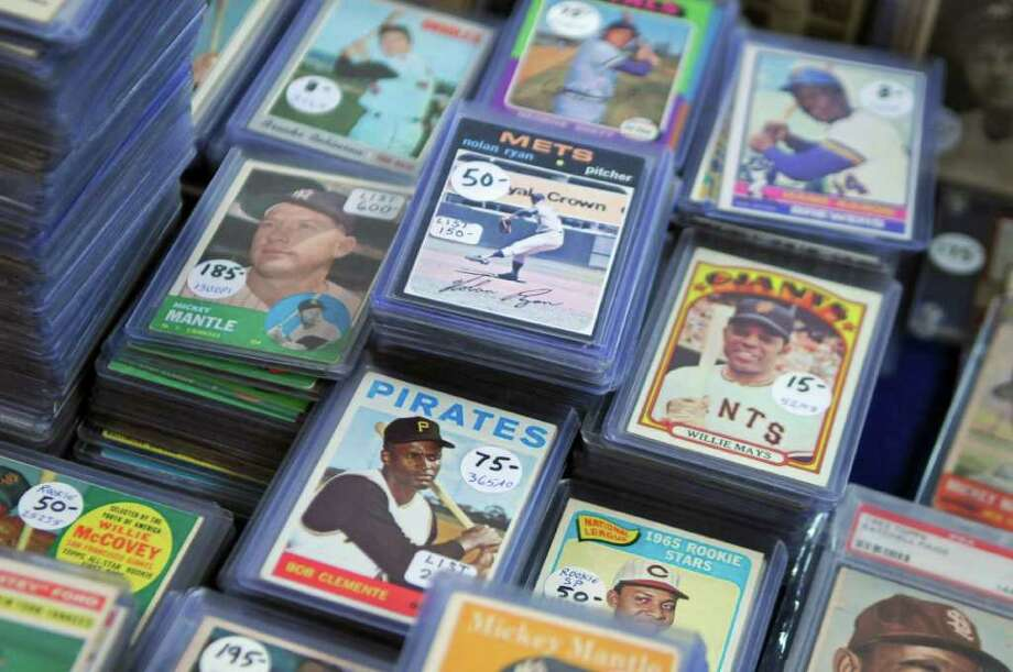 Baseball cards from the early 1970s were among those for sale by Jim Boskus of Hyde Park at the monthly Albany Sportscard Show at the Ramada on Sunday Nov. 27, 2011 in Latham, NY. Boskus has been collecting since he was about 8 years old, and brought some 100, 000 cards to show. He estimates that he has millions of cards. (Philip Kamrass / Times Union ) Photo: Philip Kamrass / 00015545A