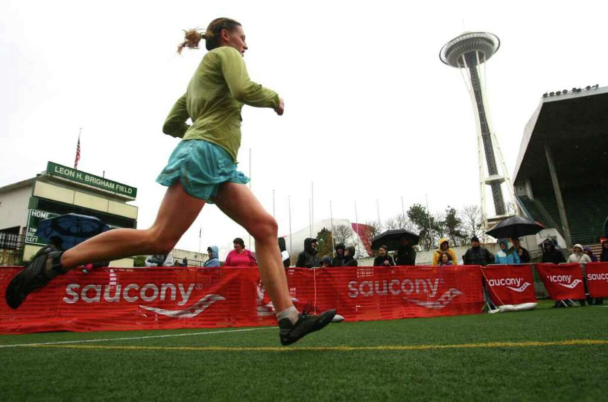 A runner heads for the finish line in Memorial Stadium during the Seattle Marathon on Sunday, November 27, 2011.