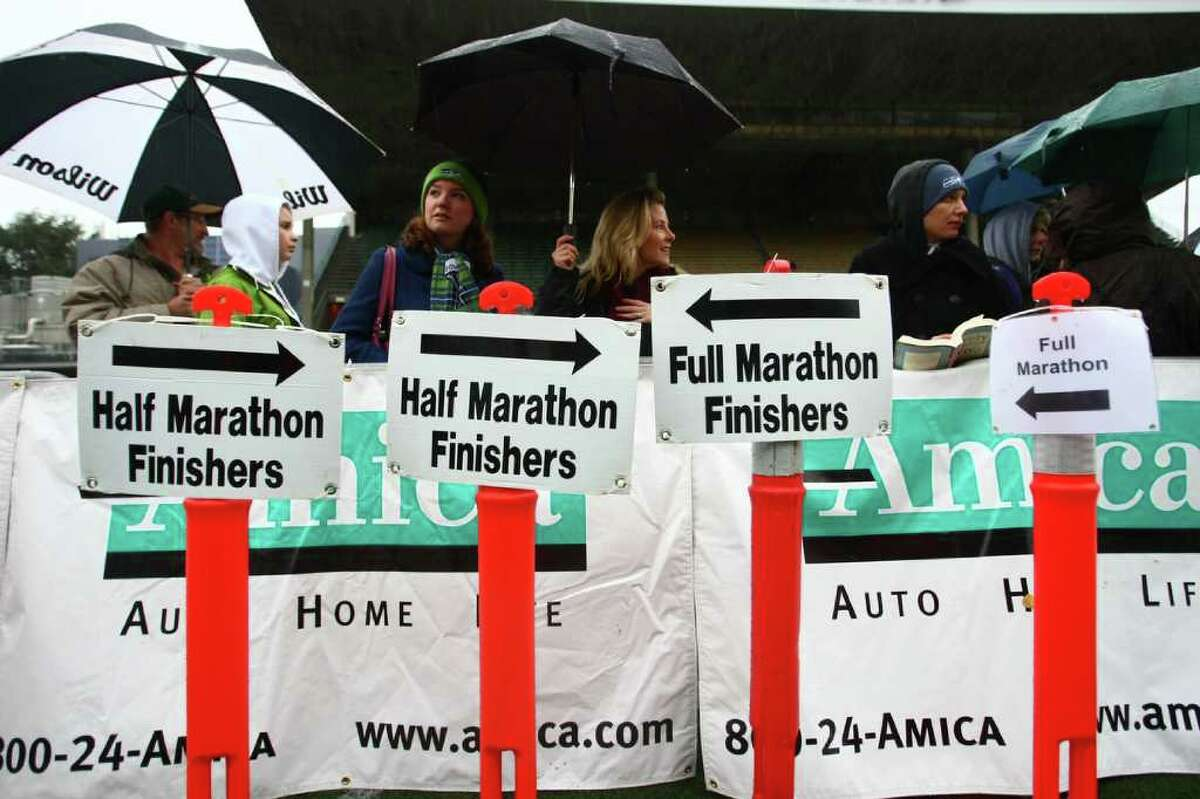 Signs wait to be placed at the finish line in Memorial Stadium during the Seattle Marathon on Sunday, November 27, 2011.