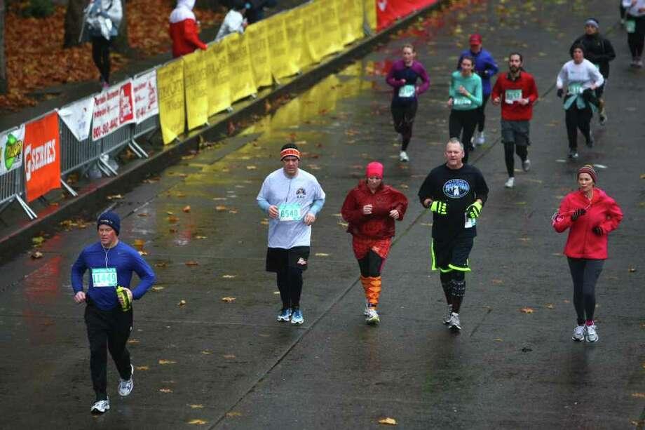 Runners head toward Memorial Stadium during the Seattle Marathon on Sunday, November 27, 2011. Photo: JOSHUA TRUJILLO / SEATTLEPI.COM