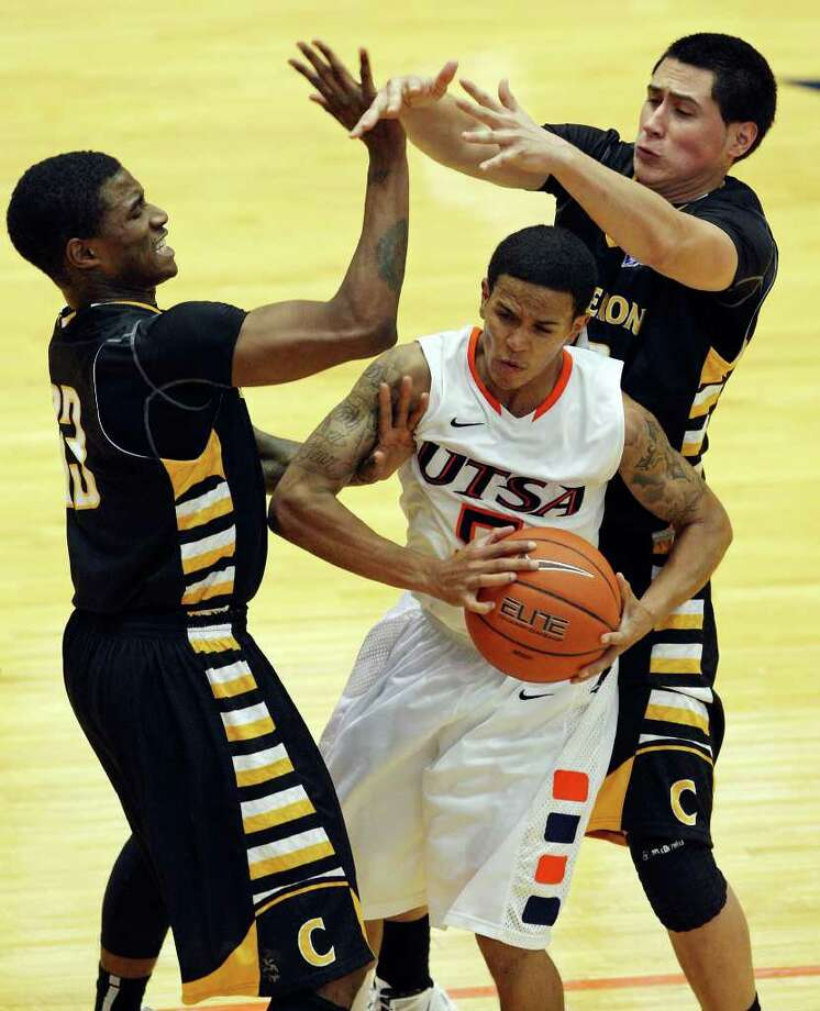 UTSA's Michael Hale III looks for room between Cameron's Thomas Razor and Cameron's Jonathan Patino during second half action Sunday Nov. 27, 2011 at the Convocation Center. UTSA won 76-48. Photo: EDWARD A. ORNELAS, Express-News / © SAN ANTONIO EXPRESS-NEWS (NFS)