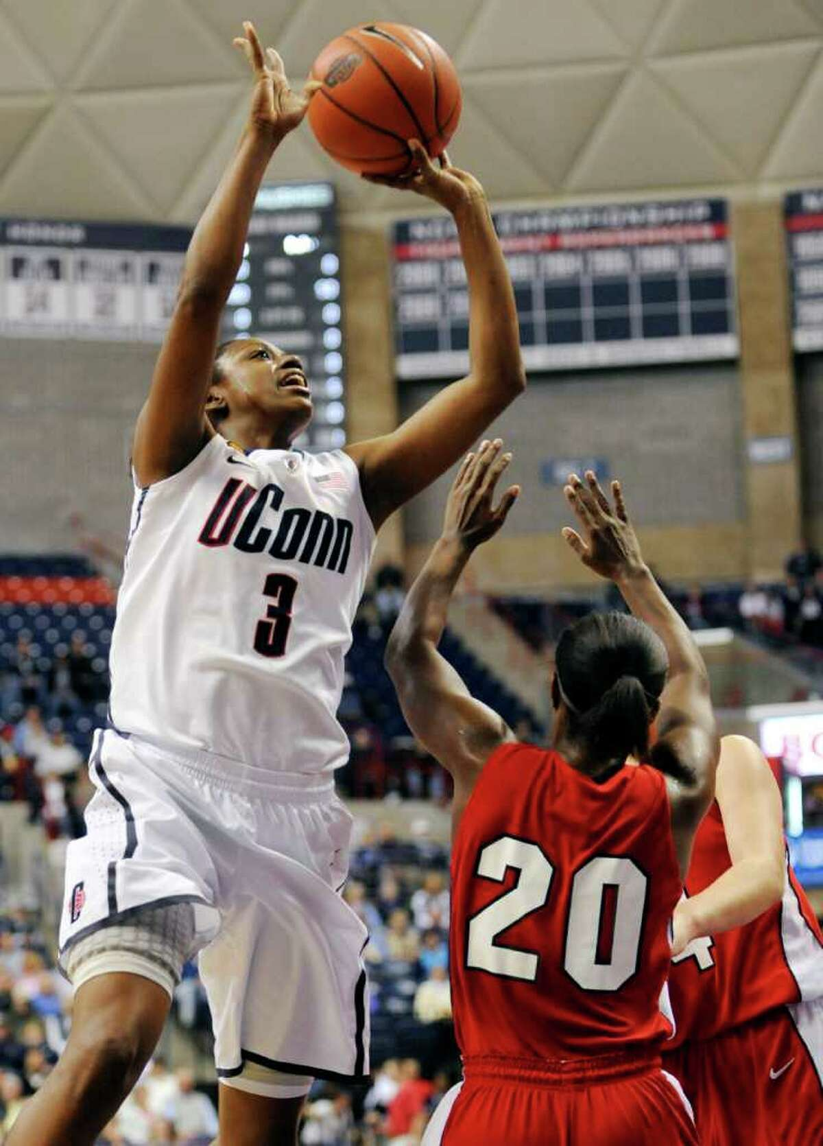 Connecticut's Tiffany Hayes (3) shoots over Dayton's Patrice Lalor (20) in the first half of an NCAA college basketball game in Storrs, Conn., Sunday, Nov. 27, 2011. (AP Photo/Jessica Hill)