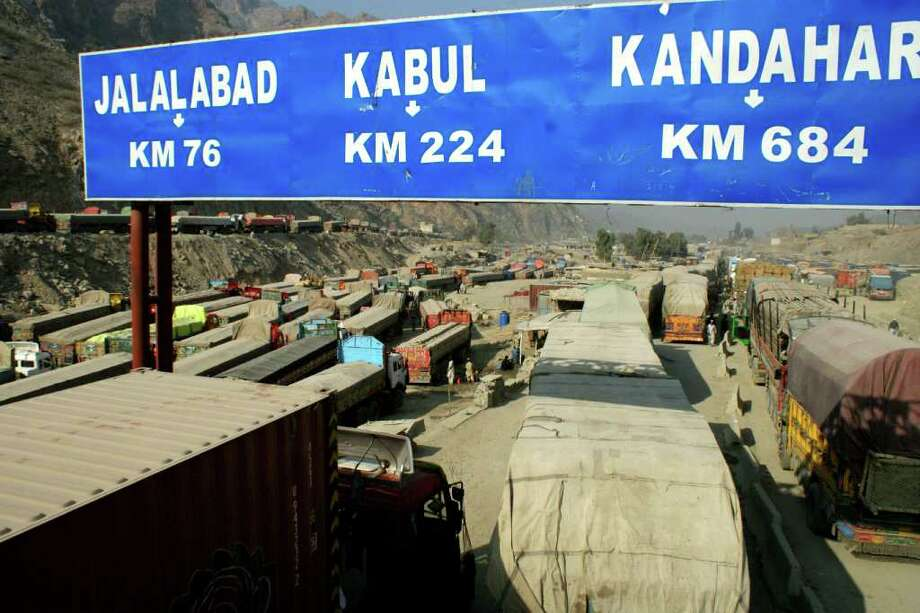 QAZI RAUF : ASSOCIATED PRESS BACKUP ON BORDER: Afghanistan-bound trucks carrying supplies for NATO forces are idly parked as the border remained closed for a second day in Pakistan on Sunday. Photo: Qazi Rauf / AP