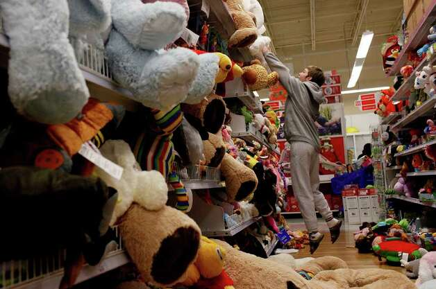 "metro - Marah Aylor, 14, tries to get down a stuffed animal at the Toys ""R"" Us and Babies ""R"" Us store in San Antonio on Thursday, Nov. 24,  2011. ""I collect them, they make me happy,"" Aylor said of her quest to find a stuffed animal to buy. LISA KRANTZ/lkrantz@express-news.net Photo: LISA KRANTZ, SAN ANTONIO EXPRESS-NEWS / SAN ANTONIO EXPRESS-NEWS"