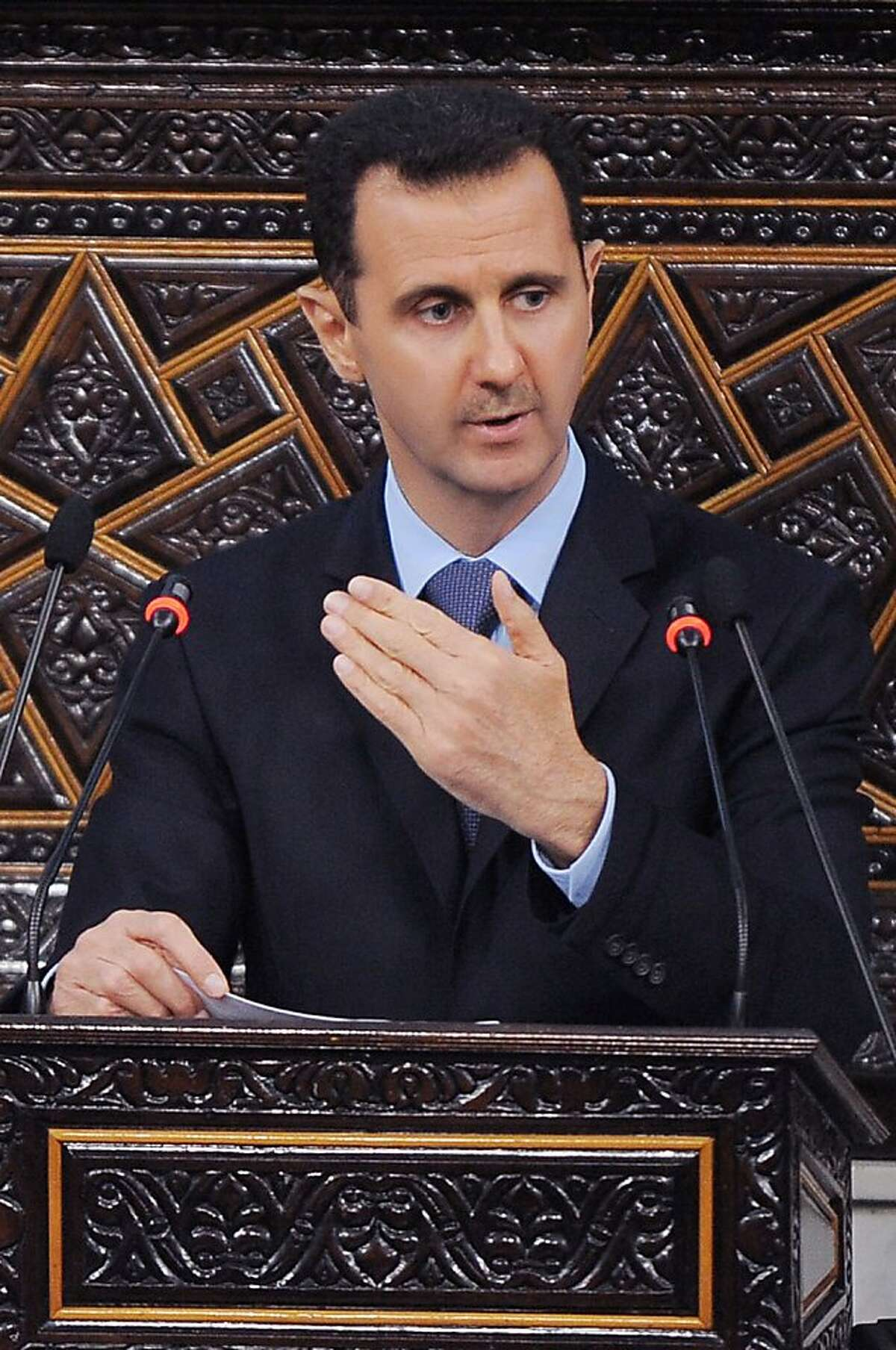 In this March 30, 2011 file photo released by the Syrian official news agency SANA, Syrian President Bashar Assad, addresses the Parliament, in Damascus, Syria. U.S. officials said Wednesday, May 18, 2011 that the Obama administration will slap sanctions on Syrian President Bashar Assad and six others for human rights abuses over their brutal crackdown on anti-government protests, for the first time personally penalizing the Syrian leader for the actions of his security forces.
