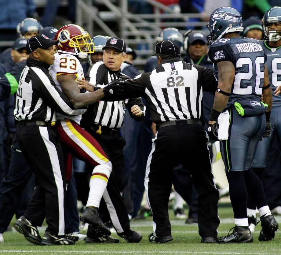 Seattle Seahawks' Michael Robinson, right, and Washington Redskins' DeAngelo Hall (23) are separated by officials after a scuffle in the first half of an NFL football game, Sunday, Nov. 27, 2011, in Seattle. Photo: AP