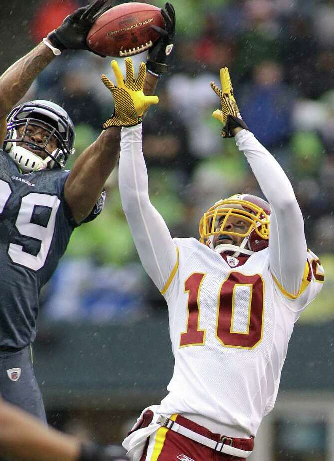 Seattle Seahawks Brandon Browner, left, intercepts a pass intended for Washington Redskins Jabar Gaffney, right, in the first half of an NFL football game, Sunday, Nov. 27, 2011, in Seattle. Photo: AP