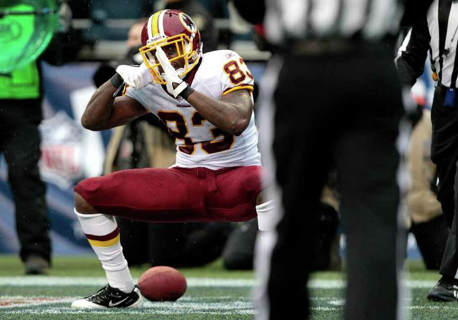 Washington Redskins Fred Davis celebrates after after catching a touchdown pass in the first half of an NFL football game against the Seattle Seahawks, Sunday, Nov. 27, 2011, in Seattle. Photo: AP
