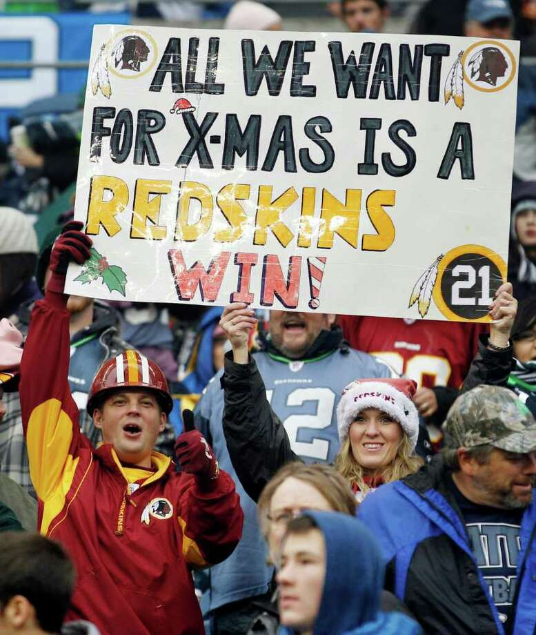 Washington Redskins hold a sign during the Redskins 23-17 win over the Seattle Seahawks in an NFL football game, Sunday, Nov. 27, 2011, in Seattle. Photo: AP