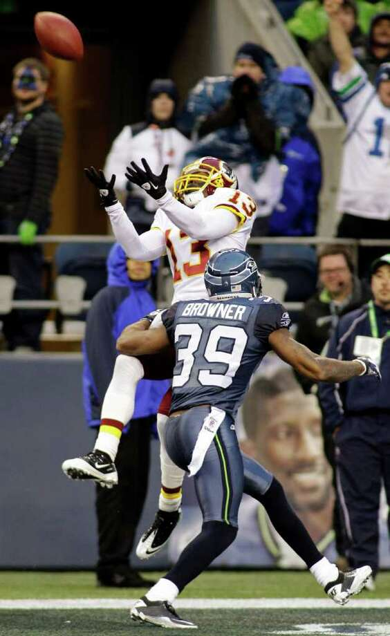 Washington Redskins' Anthony Armstrong catches a touchdown pass under pressure from Seattle Seahawks' Brandon Browner (39) in the second half of an NFL football game, Sunday, Nov. 27, 2011, in Seattle. Photo: AP