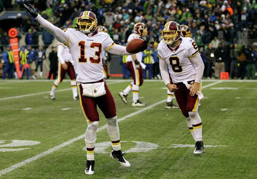 Washington Redskins' Anthony Armstrong, left, celebrates his touchdown with quarterback Rex Grossman