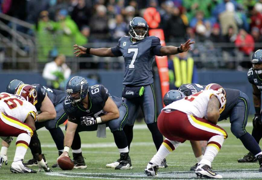 Seattle Seahawks quarterback Tarvaris Jackson (7) calls to his line  in the first half of an NFL foo