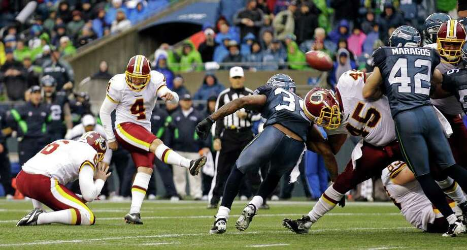 The Seattle Seahawks defense blocks a field goal attempt by Washington Redskins kicker Graham Gano (4) in the first half of an NFL football game, Sunday, Nov. 27, 2011, in Seattle. Photo: AP