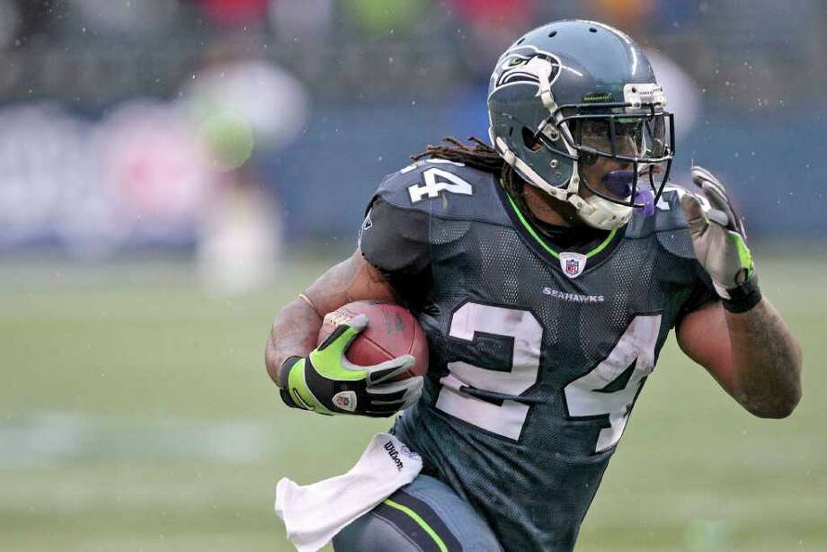 Seattle Seahawks Marshawn Lynch runs downfield in the first half of an NFL football game against the Washington Redskins, Sunday, Nov. 27, 2011, in Seattle. Photo: AP