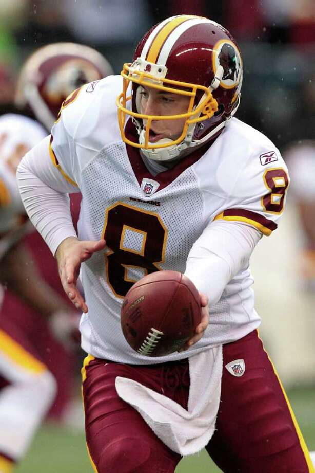 Washington Redskins quarterback Rex Grossman sets to hand off  in the first half of an NFL football game, Sunday, Nov. 27, 2011, in Seattle. Photo: AP