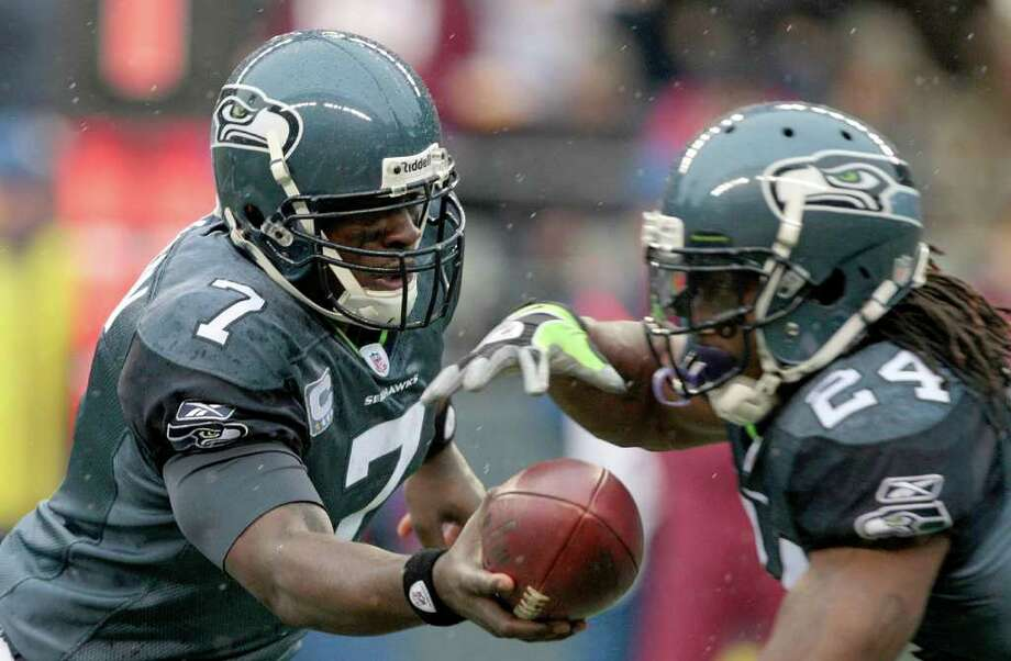 Seattle Seahawks quarterback Tarvaris Jackson hands the ball off to Marshawn Lynch in the first half of an NFL football game against the Washington Redskins, Sunday, Nov. 27, 2011, in Seattle. Photo: AP