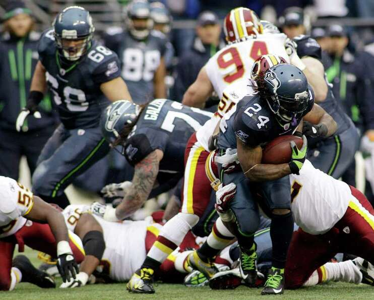 Seattle Seahawks running back Marshawn Lynch (24) looks for space against the Washington Redskins in
