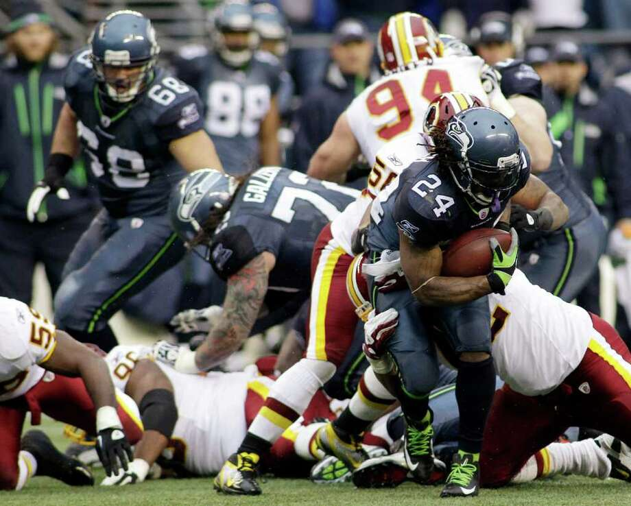 Seattle Seahawks running back Marshawn Lynch (24) looks for space against the Washington Redskins in the first half of an NFL football game, Sunday, Nov. 27, 2011, in Seattle. Photo: AP