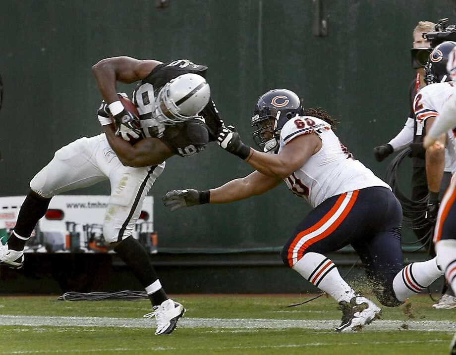 The Raiders Kamerion Wimbley got dragged down at the end of a tipped interception in the first half. The Oakland Raiders defeated the Chicago Bears 25-20 at O.co Coliseum Sunday November 27, 2011. Photo: Brant Ward, The Chronicle