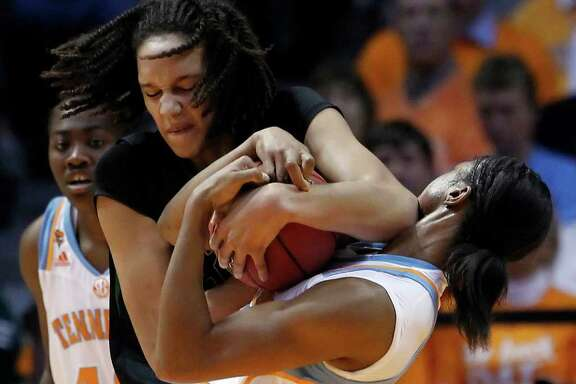 WADE PAYNE: ASSOCIATED PRESS GETTING PUSHY: Baylor's Brittney Griner, left, shows her physical side in a wrestling match with Tennessee's Vicki Baugh.