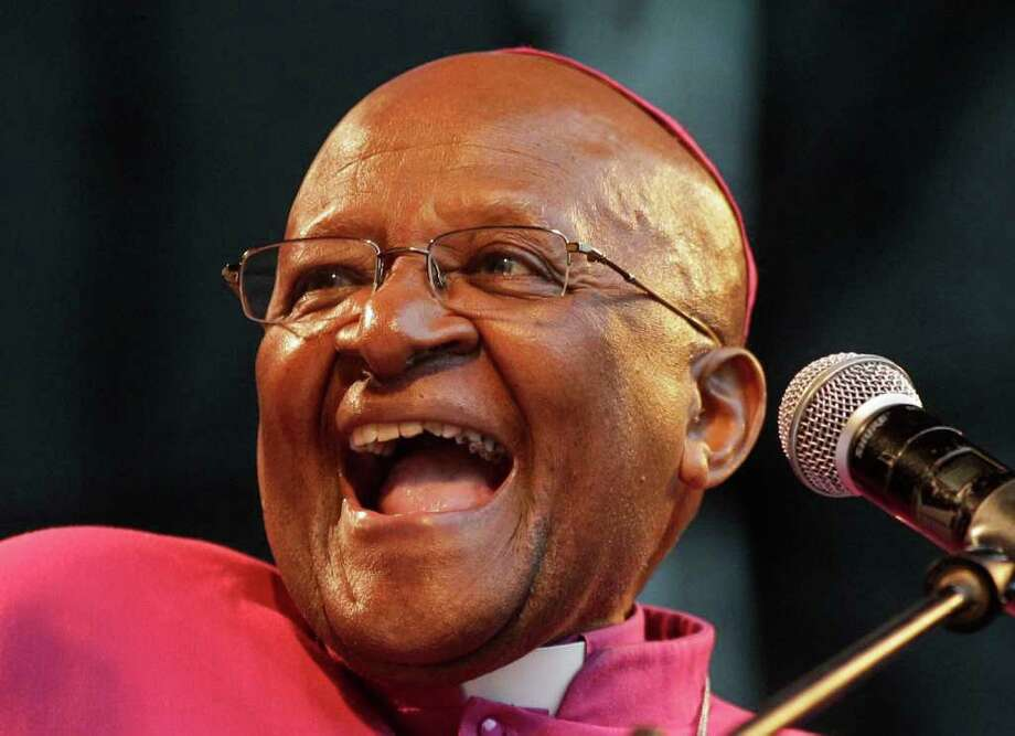 South African Archbishop Desmond Tutu reacts as he speaks during a climate justice rally held in Durban, South Africa, Sunday, Nov 27, 2011, ahead of the official start or a two-week international climate conference with about 190 countries beginning upcoming Monday. The U.N.'s top climate official, Christiana Figueres said Sunday she expects governments to make a long-delayed decision on commitments to reduce emissions of climate-changing greenhouse gases, amid fresh warnings of possible climate-related disasters in the future.(AP Photo/Schalk van Zuydam) Photo: Schalk Van Zuydam / AP