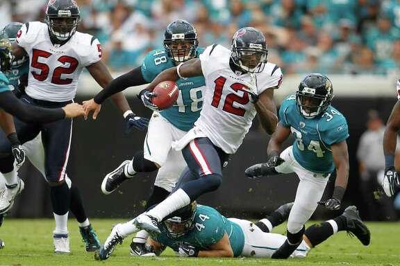 karen warren: Chronicle OFF AND RUNNING: Jacoby Jones (12) races upfield with a 42-yard punt return in the second quarter on Sunday. The return set the Texans up for Matt Leinart's 20-yard touchdown pass to Joel Dreessen.