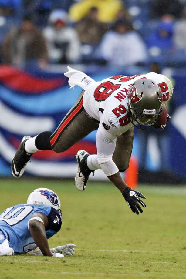 WESLEY HITT: GETTY IMAGES TAKING FLIGHT: Tampa Bay's Kregg Lumpkin is sent soaring after a hit by Tennessee's Alterraun Verner during the Titans' win Sunday at Nashville, Tenn. Photo: Wesley Hitt / 2011 Getty Images