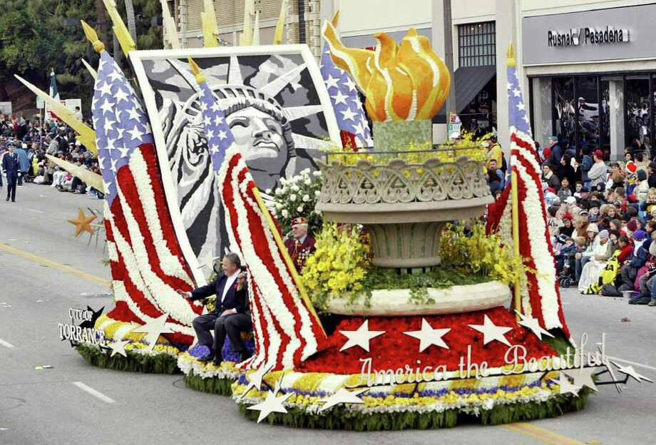 ASSOCIATED PRESS FILE PAST SPLENDOR: The city of Torrance's float, America the Beautiful, makes its way along Colorado Boulevard in Pasadena, Calif. Many cities this year can't afford a float. Photo: RIC FRANCIS / AP